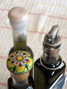 Capped bottles of Priscilla's green almond liqueur