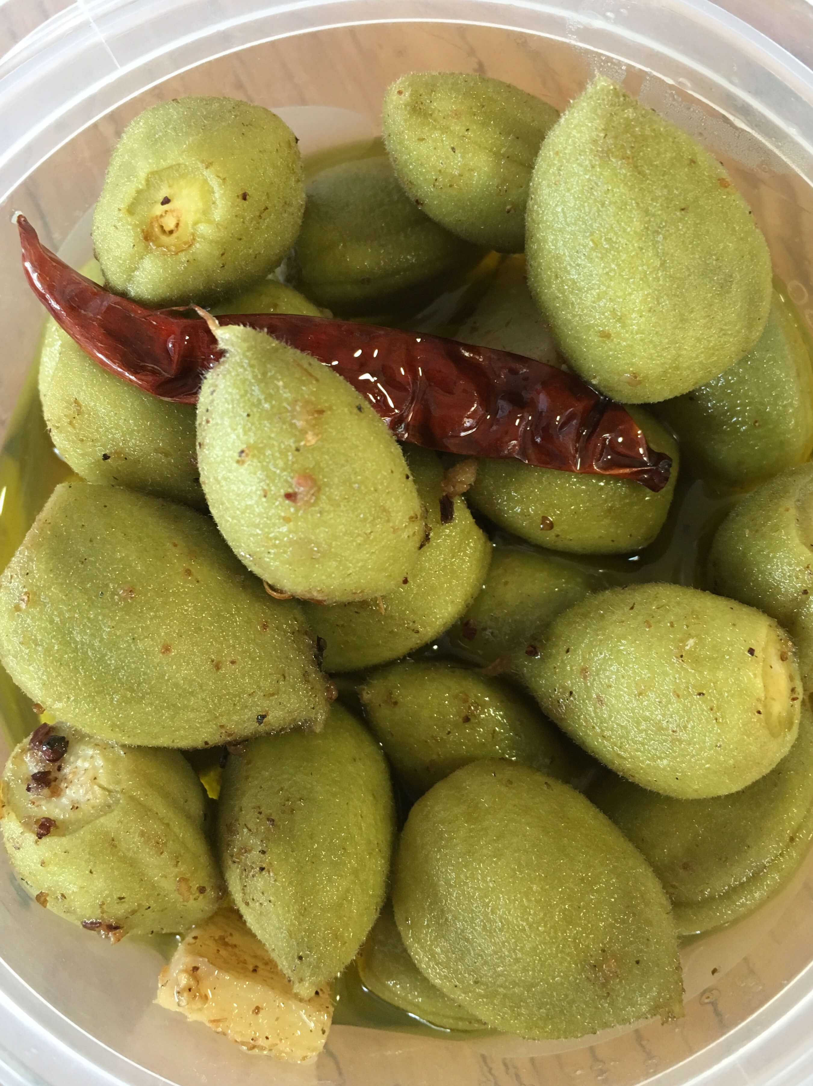 Olive Oil Poached Green Almonds with Ras el Hanout