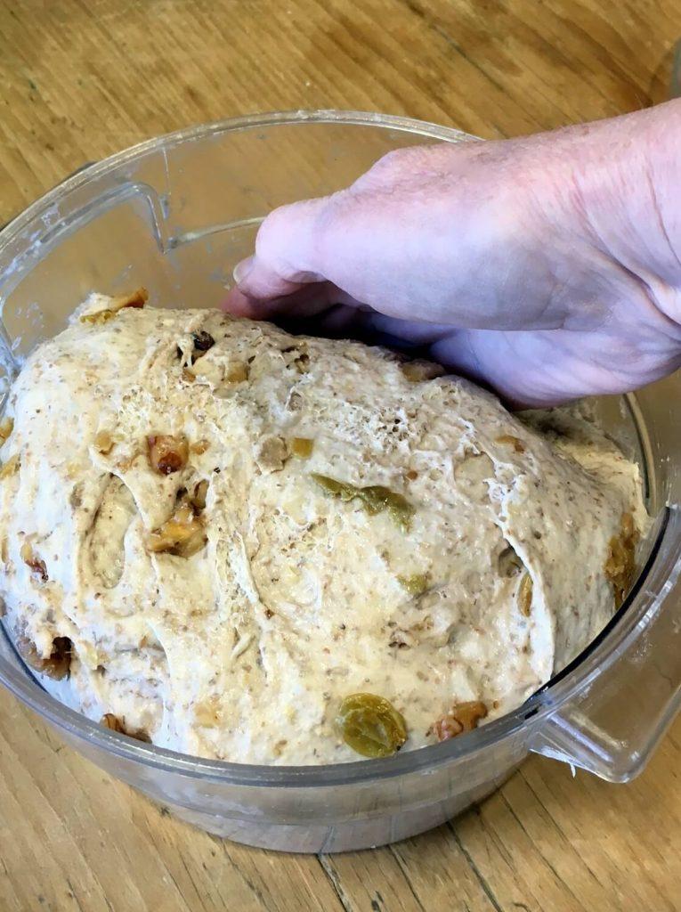 Golden Raisin Walnut Crown Loaf pushing down the dough
