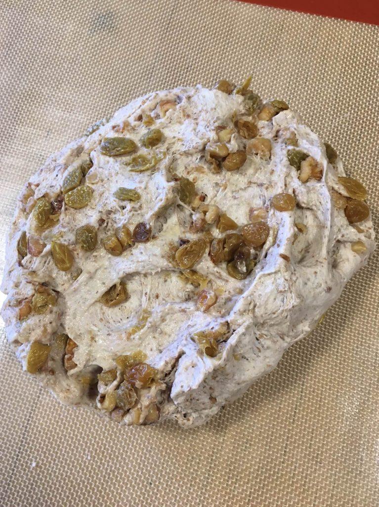 Golden Raisin Walnut Crown Loaf on the mat