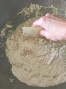 Mixing the dough with a scraper