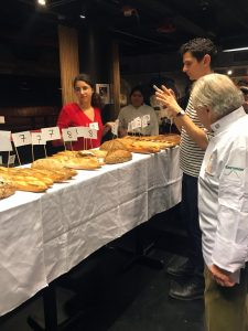 Charlie van Over studying the array of baguettes at Best baguette New York 2019