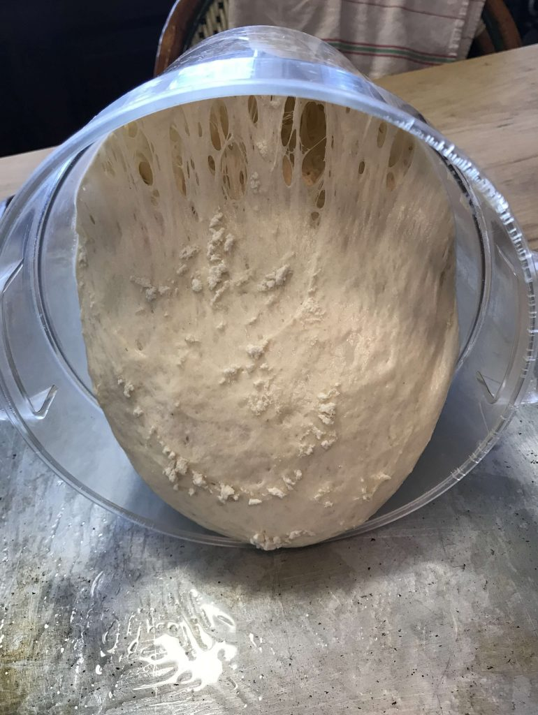 Pouring wet dough out onto the sheet pan