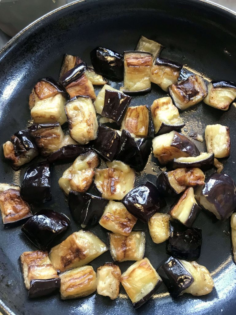 Browning and cooking the eggplant